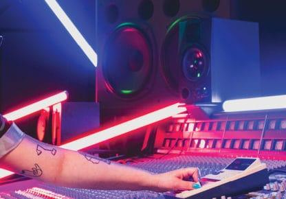 Girl sitting at recording studio console