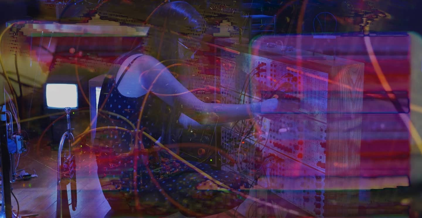 Woman in front of synthesizers